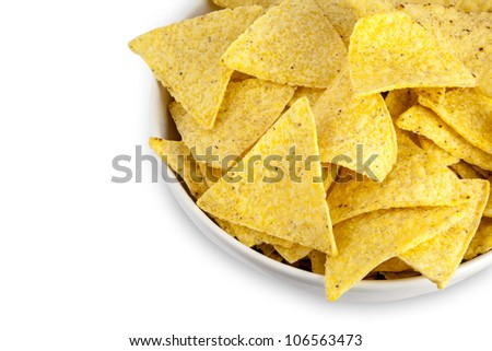 nachos corn chips in white bowl isolated