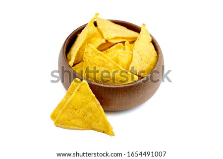 Nachos, corn chips in wooden bowl, snack isolated on white background. Fast food, suitable for vegetarians. Traditional mexican food. Selective focus