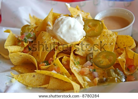 Nachos mexican snacks fried corn chips cuisine