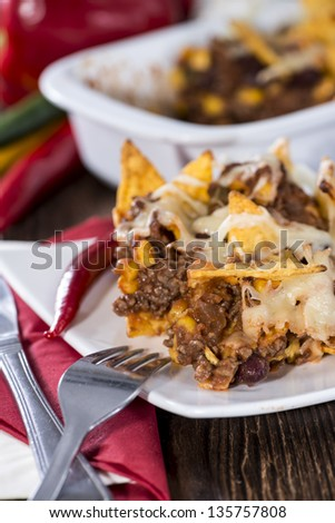 Nachos with Chili con Carne gratinated with cheese
