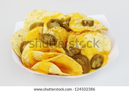 Nachos with extra cheese and peppers