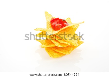 Nachos with tomato dip isolated on white background. Mexican traditional eating.