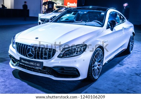 Nadarzyn, Poland, November 16, 2018: metallic white Mercedes-AMG C 63 S Coupe at Warsaw Motor Show, produced by Mercedes AMG