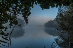 Nadeje pond with fog in summer morning near Hluboka nad Vltavou town with famous castle