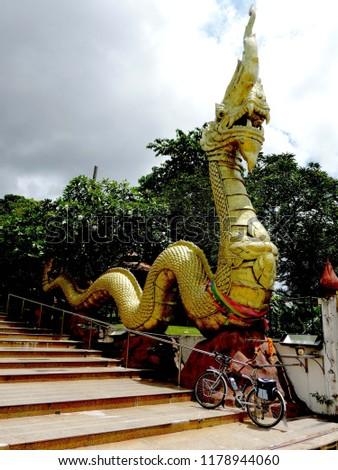 Naga and touring bike,culture city tour,candle festival,Ubonratchatani,Thailand #1178944060
