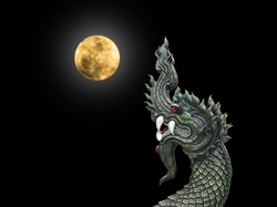 Naga Head the King of Sneak Serpent Statue  with fullmoon on black background, Phayanak or naga statue in Thailand