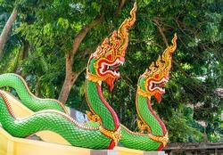 Naga snake sculpture guarding the entrance to the Thai temple. Phuket
