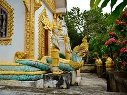 Naga statues in Buddhist Loas. Artistry of southeast asia. Dragon.