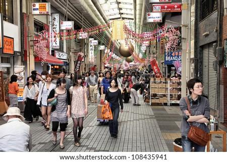 NAGOYA, JAPAN - APRIL 28: Shoppers walk along Osu Kannon covered shopping street on April 28, 2012 in Nagoya, Japan. Tripadvisor says it is currently among top 10 places worth visiting in Nagoya.