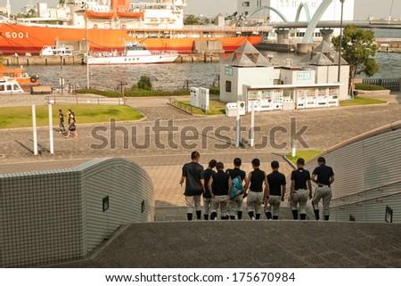Nagoya, Japan - July 28, 2012 : Japanese students with baseball cloths visit Nagoya aquarium and Fuji Icebreaker boat in Nagoya port