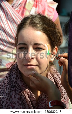 Indian Girl with Indian Flag painted on… Stock Photo 450689452