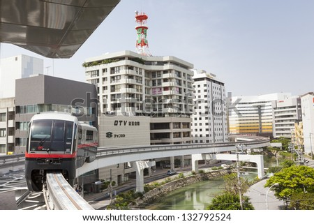 NAHA, JAPAN - APRIL 1: A train snakes past modern buildings on the Okinawa City Monorail line in Naha, Japan on 1st April 2012. The mono rail is the only working railway in Okinawa prefecture.