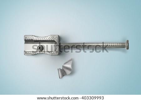 Nail and sharpener. Creative concept