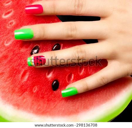 Nail art manicure. Watermelon style bright summer Art Manicure. Nail Polish. Beauty hands. Trendy Stylish Colorful Nails and Nailpolish