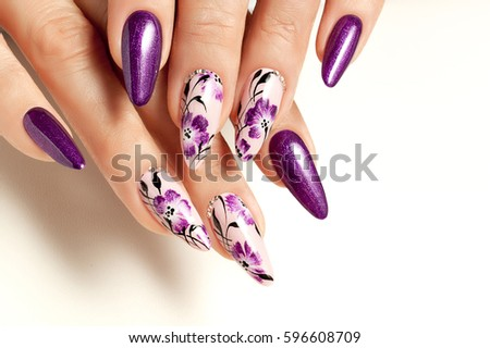Nail art service. Female manicure and floral patterns. #596608709