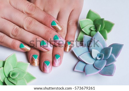 Nail art with bright gold, pink and green chevron pattern on light background #573679261
