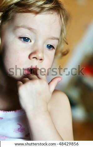 nail-biting - bad habit for children in soft focus