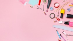 Nail care. A set of professional tools for manicure and pedicure. Beauty care. Coating nails with gel polish. Tools for creating and for the treatment of nails. Salon Banner Pink Background