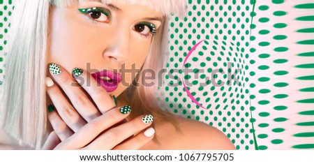 Nail design and makeup with green dots on model on background with dots. #1067795705