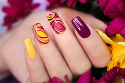 Nail design on shiny and matte nail Polish with smooth curves.Fashionable multicolored manicure.