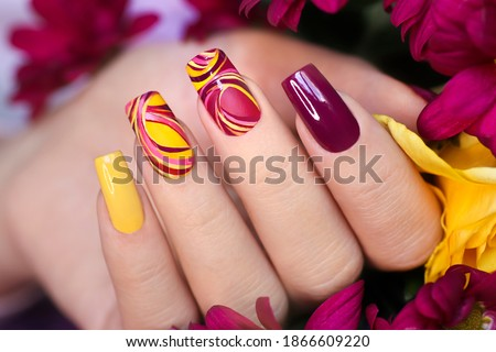 Nail design on shiny and matte nail Polish with smooth curves.Fashionable multicolored manicure. Stock photo ©