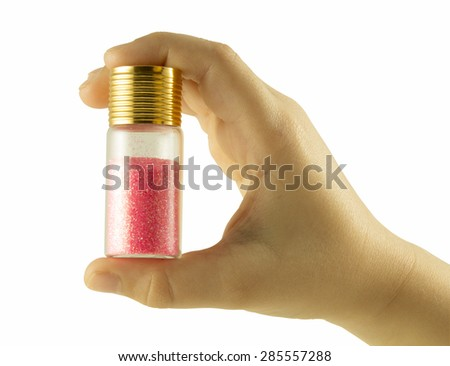Nail glitters on hand isolated with clipping path on white background