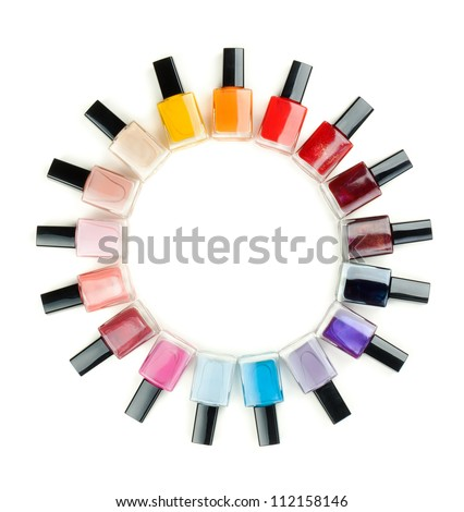Nail polish arranged in a circle on a white background