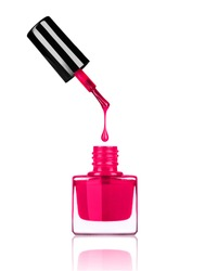 Nail polish dripping from brush into bottle on white background