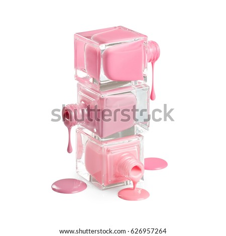 Nail polish dripping from stacked bottles isolated on white background #626957264