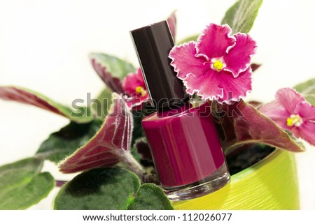 Nail Polish with Violet flower on a white background.