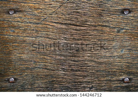 nails and shadows in wood