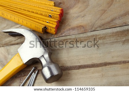 Nails, hammer and folding ruler
