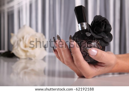 Nails with rose and perfume - stock photo
