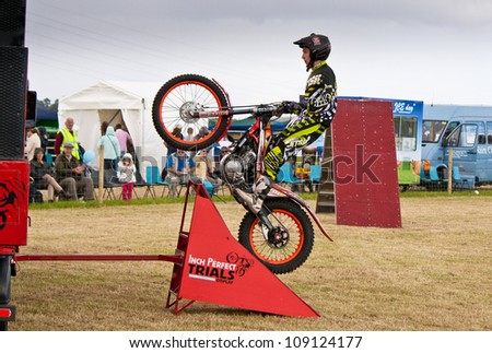 NAIRN, SCOTLAND - JULY 28: Ben Butterworth from the Inch Perfect Trials Display Team performs at the annual Nairnshire Farmers Show on JULY 28, 2012 in Nairn, Scotland