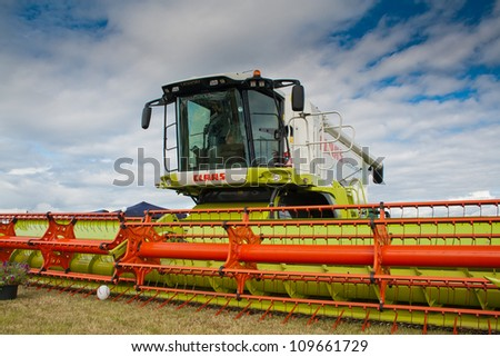 NAIRN, SCOTLAND - JULY 28: Claas Lexion 580 combine harvester on display at the annual Nairn Farmers Show on July 28, 2012 in Nairn, Scotland