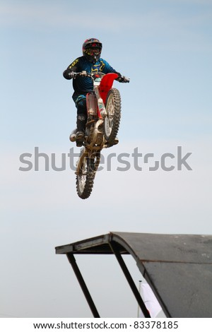 NAIRN, SCOTLAND - 30 JULY: Dan Clark from the Xtreme Motor Cycle Display Team performs at the annual Nairnshire Farmers Show on 30 July 2011 in Nairn, Scotland