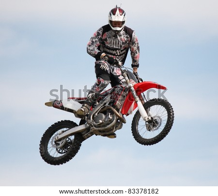 NAIRN, SCOTLAND - 30 JULY: Martin Crosswaite from the Xtreme Motor Cycle Display Team performs at the annual Nairnshire Farmers Show on 30 July 2011 in Nairn, Scotland