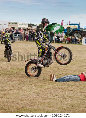 NAIRN, SCOTLAND - JULY 28: Matthew Alpe from the Inch Perfect Trials Display Team performs at the annual Nairnshire Farmers Show on JULY 28, 2012 in Nairn, Scotland