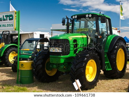 NAIRN, SCOTLAND - JULY 28: New John Deere 6930 tractor on display at the annual Nairn Farmers Show on July 28, 2012 in Nairn, Scotland