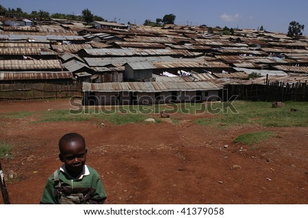 NAIROBI, KENYA - 27 JANUARY 27: Children living in the slums of Kibera on 27 January 27, 2004 in Nairobi, Kenya. The largest slum of Africa is in Nairobi. About 270 thousand people living in Kibera