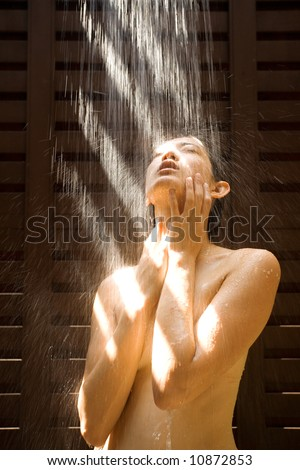 stock photo : Naked Asian girl under outdoor strong shower
