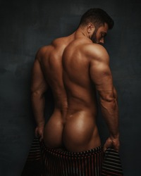 Naked bodybuilder back with towel