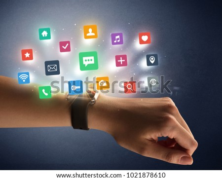 Naked female hand with smartwatch and  application labels around and dark background #1021878610