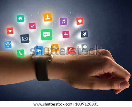 Naked female hand with smartwatch and  application labels around and dark background #1039128835