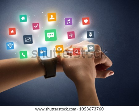 Naked female hand with smartwatch and  application labels around and dark background #1053673760