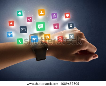 Naked female hand with smartwatch and  application labels around and dark background #1089637505