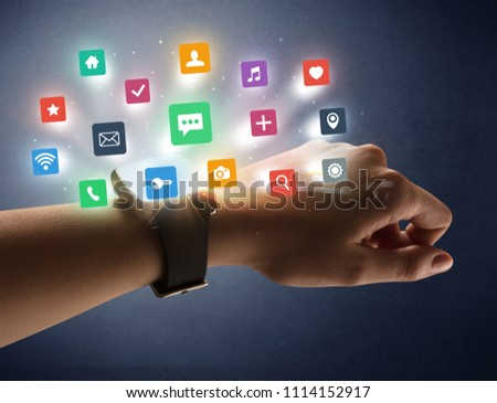 Naked female hand with smartwatch and  application labels around and dark background #1114152917