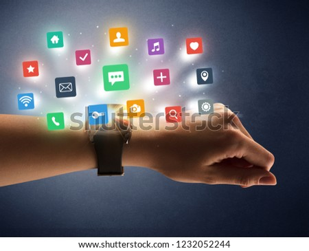 Naked female hand with smartwatch and  application labels around and dark background #1232052244