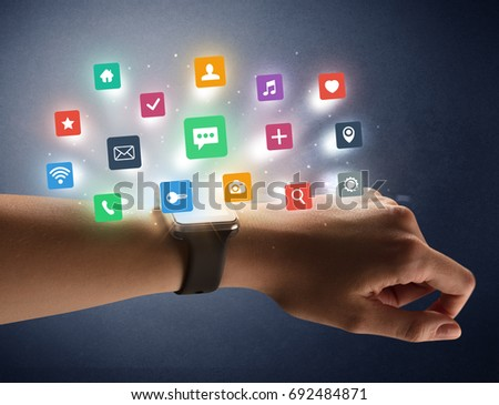 Naked female hand with smartwatch and  application labels around and dark background #692484871