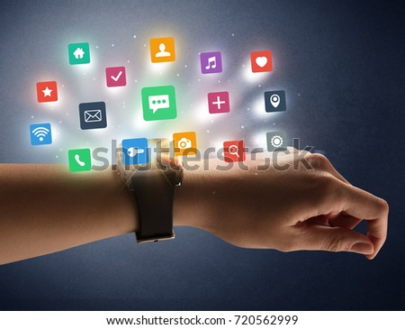 Naked female hand with smartwatch and  application labels around and dark background #720562999